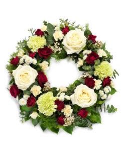 Snittblomster * Begravelse - Elegant begravelseskrans : Roser, krysantemum, nelliker, viburnum med årstidens grønt
